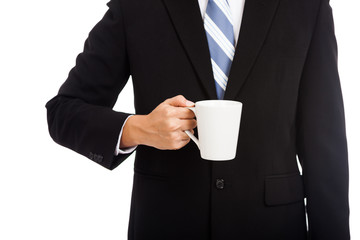 Asian businessman hold a cup of coffee