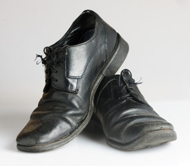 Worn and dirty blackshoes