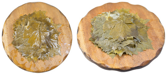 set of marinated grape leaves on wooden boards