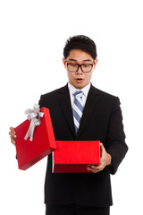 Asian businessman surprise open red gift box