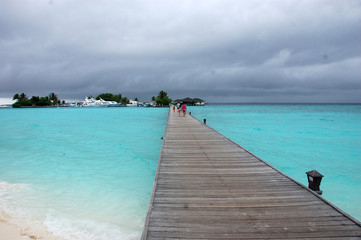 Long timber pier at Paradise Island Resort Maldives