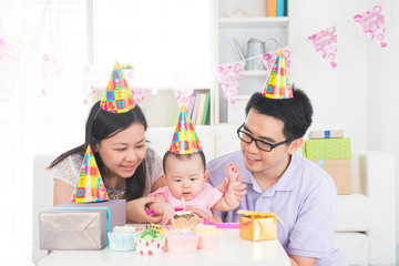 asian family celebrating full moon birthday with baby