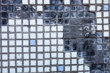 Surface of the old and damaged small square tiles