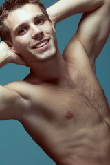Male beauty concept. Portrait of handsome muscular male model