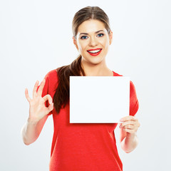 portrait of young woman holding sign card with O.K.