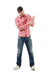 Man dressing plaid shirt buttoning sleeve buttons