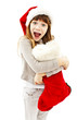 Excited Little girl with Christmas gift on white background