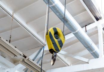 warehouse interior with crane hook