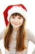 Little girl in red Santa hat. Isolated on white background