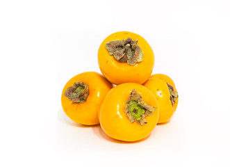 yellow persimmons isolated on white background with shadow