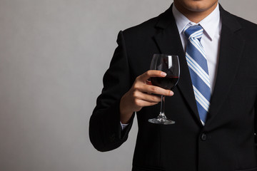 Asian businessman body with glass of red wine