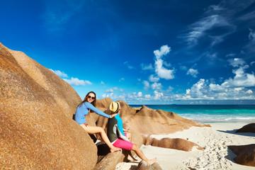 Couple at tropical beach wearing rash guard
