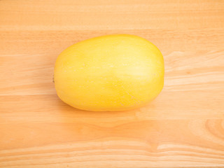 Whole Spaghetti Squash on Wood Table