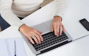 Overheadview of a woman working with laptop.