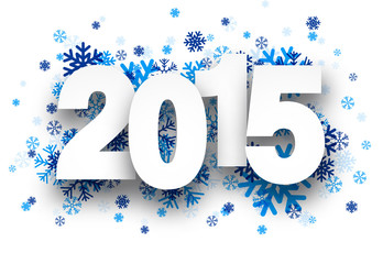 2015 paper sign over snowflakes.