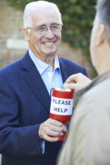 Senior Man Collecting Money For Charity