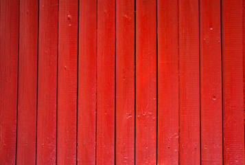 Red painted wooden fence panels.