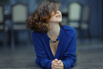 Portrait of a cheerful girl in a sexy blue