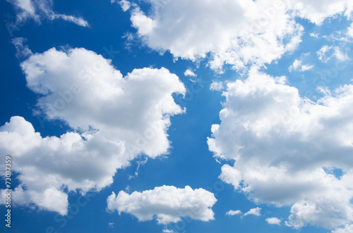 White clouds in blue sky. - 73037359