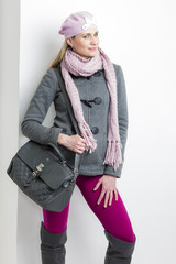 portrait of woman wearing winter clothes with a handbag