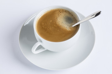 Cup of coffee on a white plate on white background