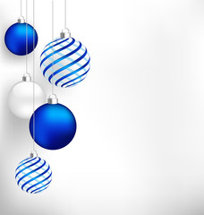 Blue spiral christmas balls hang on white background