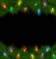 Multicolored Christmas lights on pine branches on black backgrou