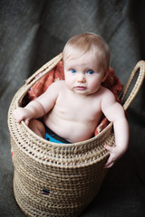 Surprised baby in the basket