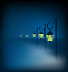 Lanterns stand in fog on dark blue background