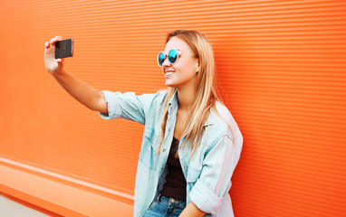Summer, fun, technology and people concept - cool hipster girl m