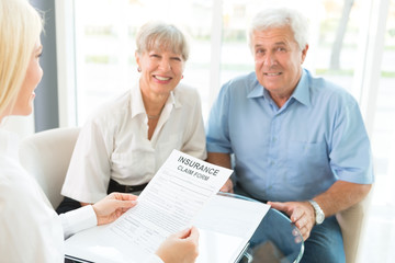 Elderly couple purchasing life insurance