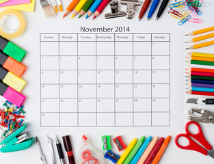 Monthly calendar with office and stationery for November 2014