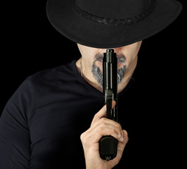 The man in black holding a gun