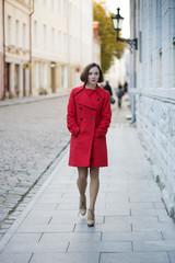Woman walk by street in old city