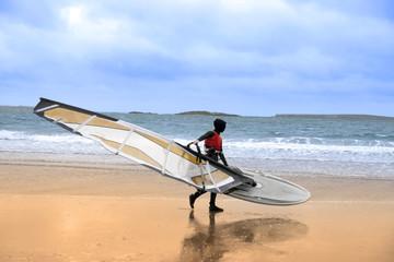 lone wild Atlantic way windsurfer getting ready to surf