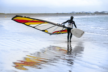 lone windsurfer getting ready to surf