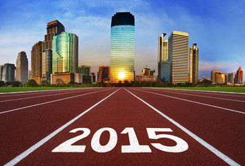 New Year 2015 on running track concept with modern city.