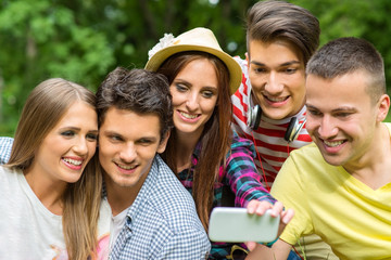 Friends Taking a Photo Together with Smartphone