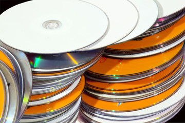 Closeup View of Stacked Colorful Compact Disks