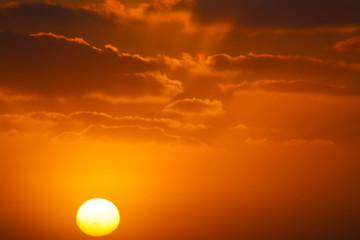 shining sun in an orange sunset
