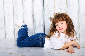 little girl lying on floor
