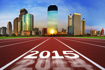 New Year 2015 on running track concept with blue sky.