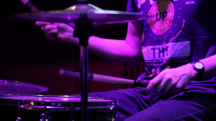Drummer play in a nightclub