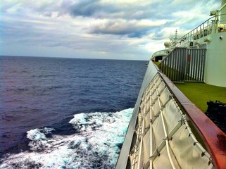 Onboard upper deck of cruise line ship on pacific ocean