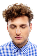 Portrait of a casual man with closed eyes on white background