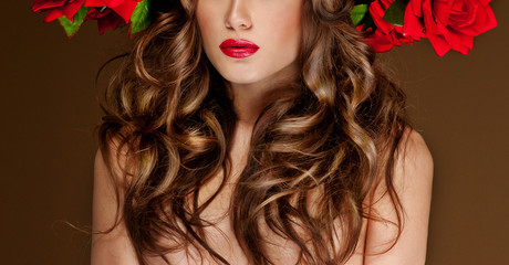 beautiful woman with red roses in her hair