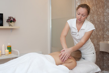 Young girl runs a massage in the beauty salon