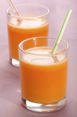 carrot and turnip smoothie in a shot glass