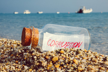 "Message in a bottle with text ""corruption"""
