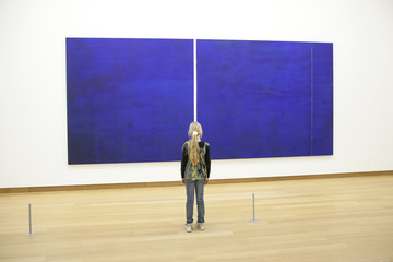 young girl in Stedelijk museum before painring of Barnett Newman